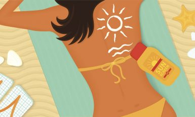Young girl sunbathes on a beach and caring about her health she uses sunscreen